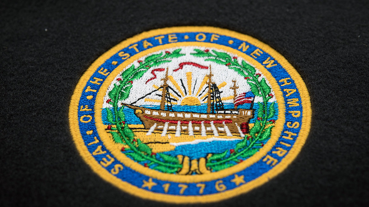 [Translate to Thailändisch:] New Hampshire state logo embroidered with Madeira threads